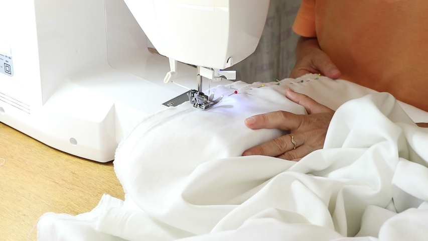 Sewing artisanally made clothes in his studio | Shutterstock HD Video #1035231485