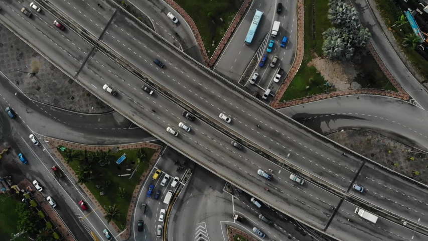 Aerial shot top view of the flyover bridge and the curve cross junction  | Shutterstock HD Video #1035277535