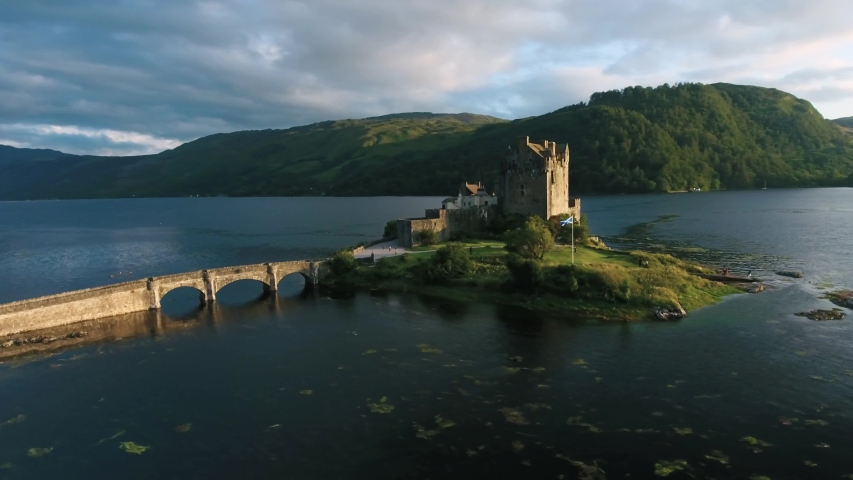 Famous Eilean Donan Castle in Scotland aerial shot from drone