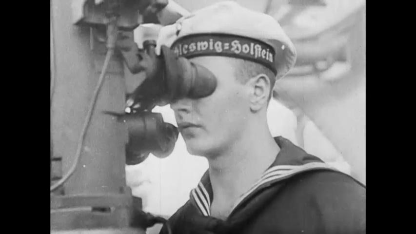 CIRCA 1939 - A German Navy vessel bombards Danzig.