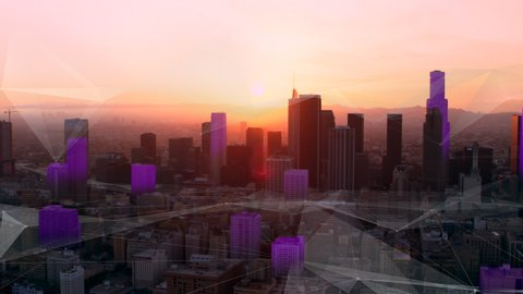 LA Aerial connected smart city sunset golden hour lighting with futuristic network and technology. Wide shot on 4k RED camera on helicopter