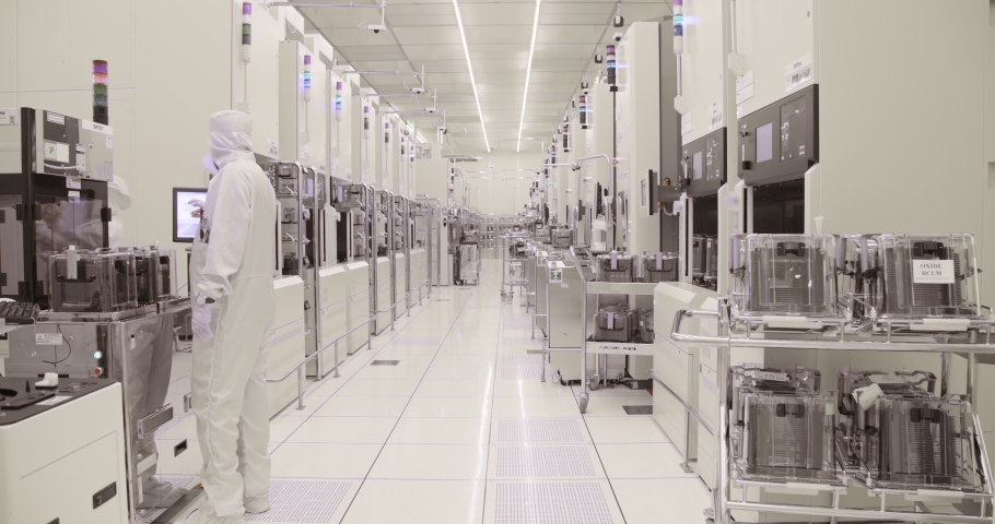 Clean room manufacturing of silicon wafers for the semiconductors industry | Shutterstock HD Video #1035694985