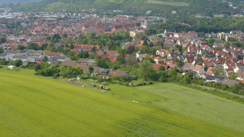 Aerial view from the old part of the city Bad Mergentheim in germany. Pan to the right beside the town.   Shutterstock HD Video #1035717305