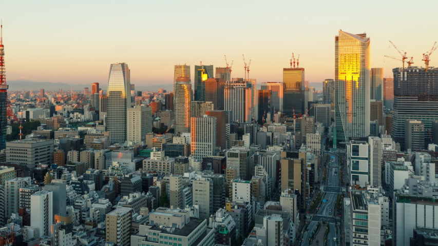 Time Lapse of the densely packs buildings of Tokyo Japan at sunrise | Shutterstock HD Video #1035931115