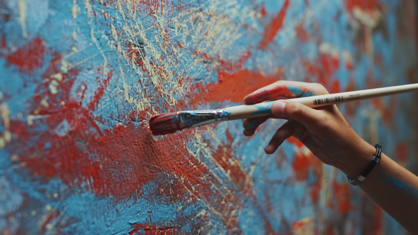 Close-up Shot of Female Artist Hand, Holding Paint Brush and Drawing Painting with Red Paint. Colorful, Emotional Oil Painting. Contemporary Painter Creating Modern Abstract Piece of Fine Art | Shutterstock HD Video #1036107785