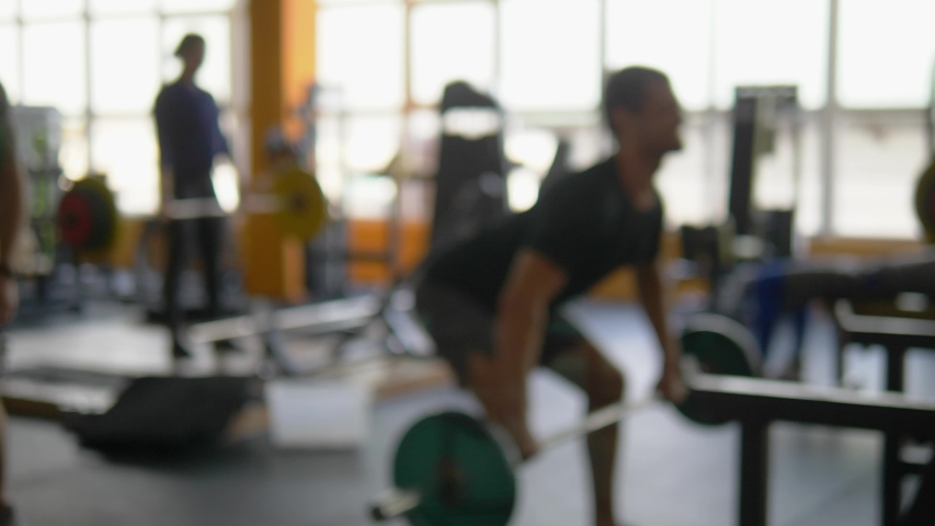 Blur background. barbells in the gym. Blurred fitness room with weight training bar   Shutterstock HD Video #1036456925