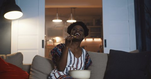 Image result for picture of black woman watching movies at home