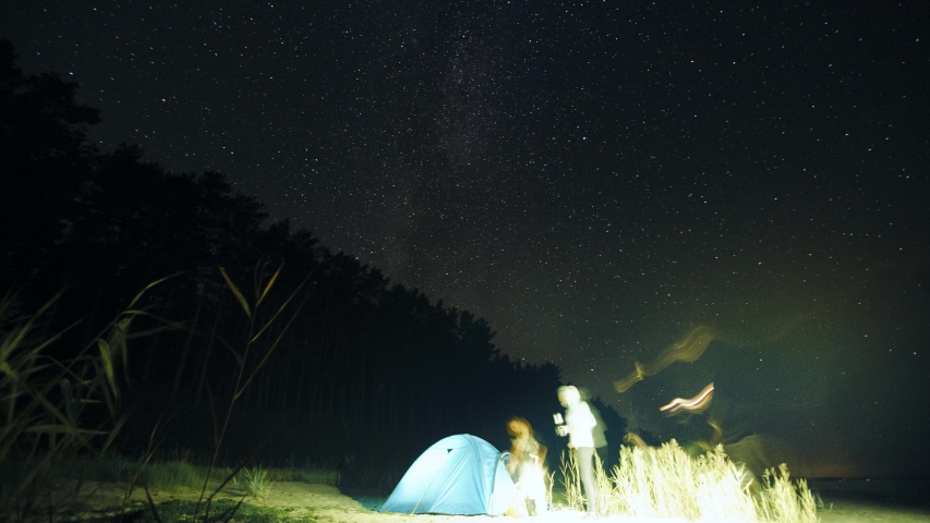 8K traveling Tent is assembled: Milky way starry night timelapse w panning camera | Shutterstock HD Video #1036486565