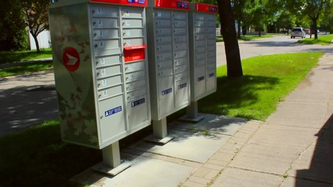 Winnipeg , MB / Canada - 07 27 2019: Winnipeg, MB / Canada - July 27, 2019: Walking up to the Canada post mail boxes.