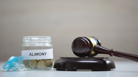 Gavel striking sound block, alimony glass jar and pacifier table, child support