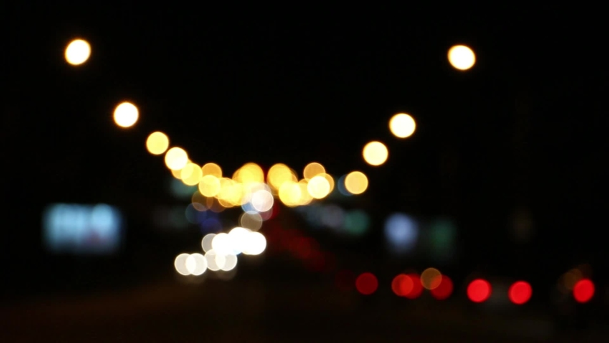 Blurred car lights at the crossroads of the big night city   Shutterstock HD Video #1036901195