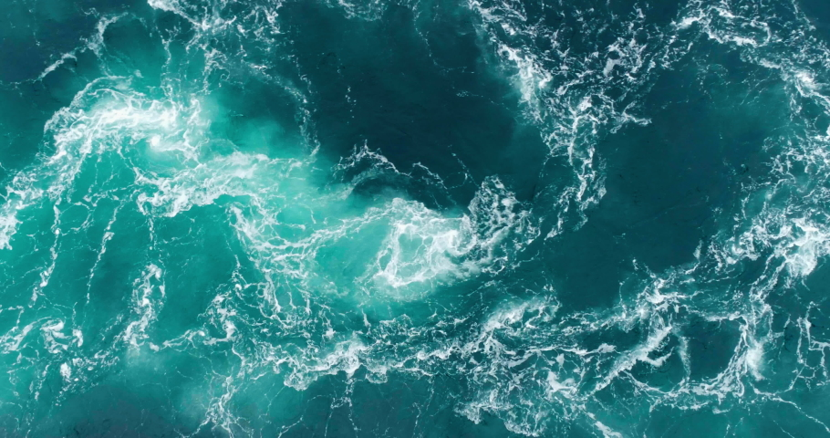 4K drone video with birds-eye view of the abstract and powerful water currents, rapids and whirlpools of the worlds larges maelstrom Saltstraumen in Bodø, Norway. | Shutterstock HD Video #1036929425