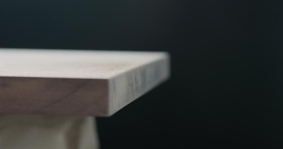 Slow motion woodworker touching untreated black walnut board | Shutterstock HD Video #1037092025