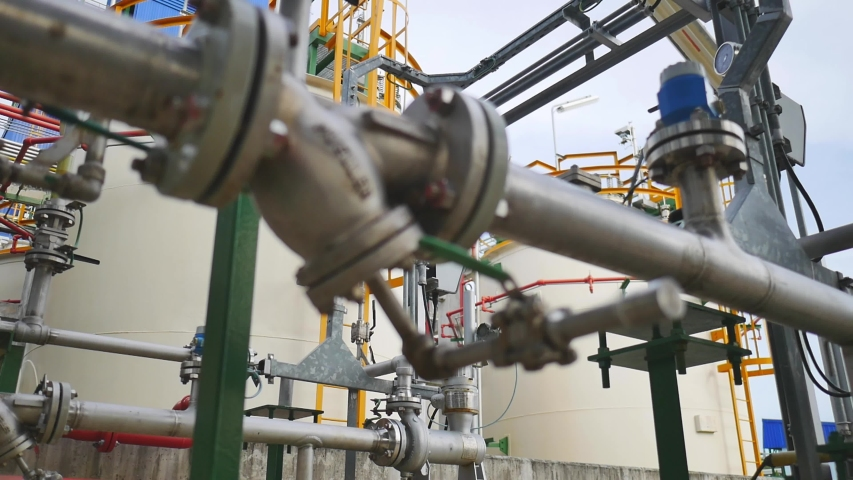 Complex engineering of Oil or chemical storage tank in petrochemical refinery industry plant in petroleum and heavy industrial plant , Panning video