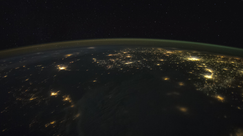 Planet Earth seen from the International Space Station with Aurora Borealis over the earth with illuminated cities, Time Lapse 1080p. Zoom out motion. Images courtesy of NASA Johnson Space Center | Shutterstock HD Video #1037225285