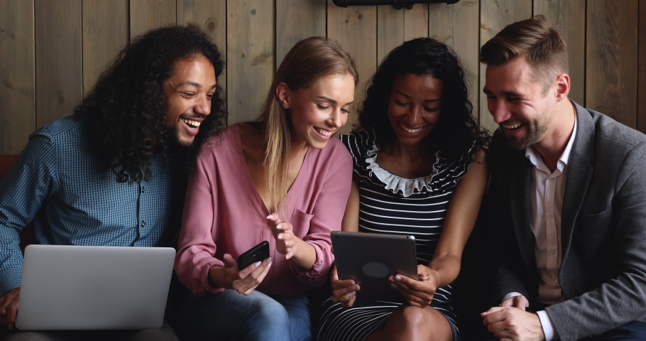 Happy multiracial young friends making group online conference video call together waving hands having fun doing social media app chat using tablet computer, people and digital communication concept   Shutterstock HD Video #1037298335