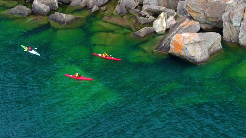 Kayaking Through Rocky Water, Cliffs, Aerial Drone | Shutterstock HD Video #1037304425