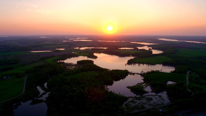 Marsh, Wetlands, River at Sunset, 4K Aerial Drone Shot | Shutterstock HD Video #1037358305