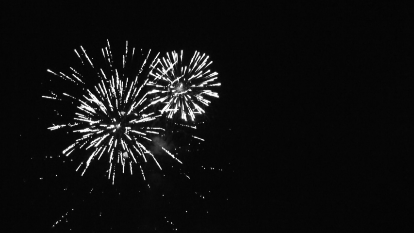 4K. loop seamless of real fireworks background. abstract blur of real golden shining fireworks with bokeh lights in the night sky. glowing fireworks show. New year's eve fireworks celebration | Shutterstock HD Video #1037447555