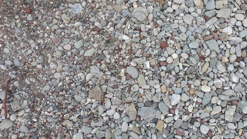Top view video of stones on the beach on the sea. | Shutterstock HD Video #1037523845