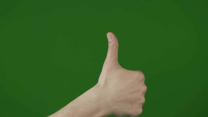 Hand gesturing like on green background. Strong male arm. | Shutterstock HD Video #1037552015