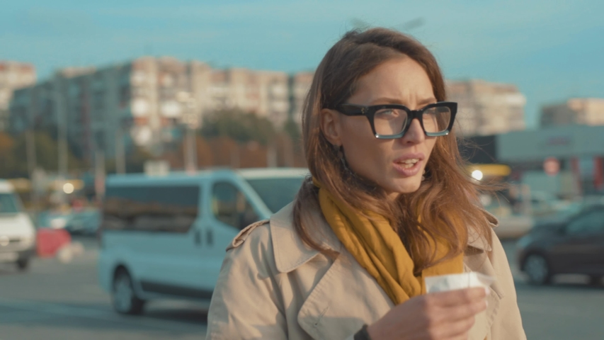 Stylish young woman with glasses walk coughs feel sick sneeze holds a handkerchief at outdoor fever cold allergy female nose sneeze lady runny tissue air pollution adult illness district slow motion | Shutterstock HD Video #1037883365