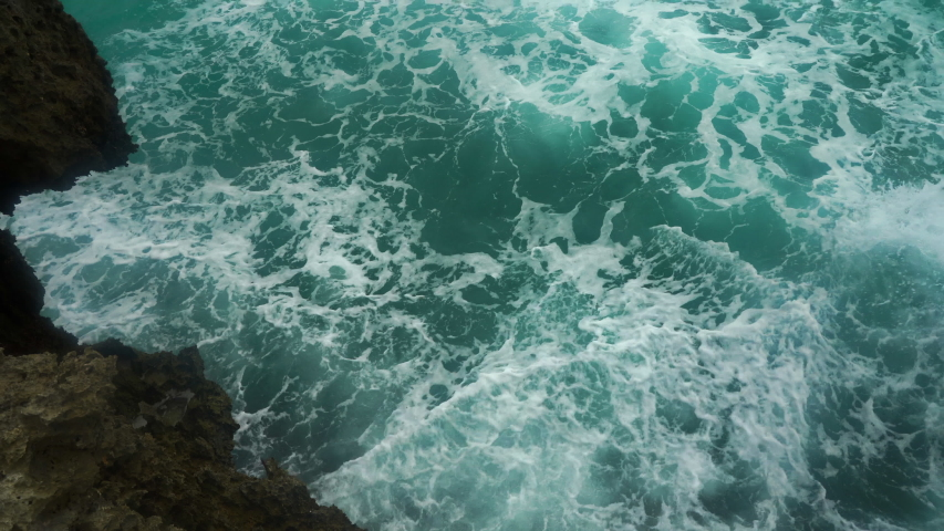 sea wave abstraction. wave and foam in the ocean at the end day. blue foam of the pacific ocean. stormy sea, wave crushing on the volcanic shore #1038017735
