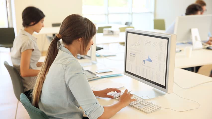 Young people in business training, working on desktop | Shutterstock HD Video #10381289