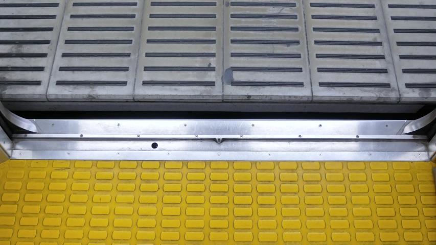 Zooming into train, metro's door (inside the train) while train door's closing (Foot-ant eye view) -4K UHD videoie footage short   Shutterstock HD Video #1038233075