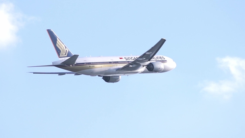 Ho Chi Minh City, Vietnam - September 11th, 2019: Airplane Boeing 777 of Singapore Airlines flying through sky take off from Tan Son Nhat International Airport, Ho Chi Minh City, Vietnam