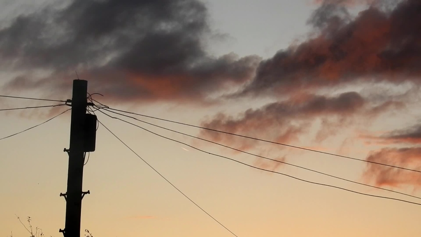 Colourful morning sunrise orange clouds passing behind telephone pole communication lines. Timelapse.   Shutterstock HD Video #1038877505