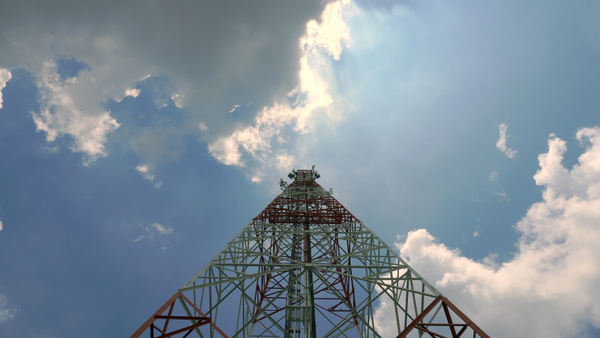Time Lapse Signal tower or Mobile phone tower with dayligth sky and white cloud. Telecommunication tower Antenna.Modern communication concept by using 5 g internet   Shutterstock HD Video #1038887255
