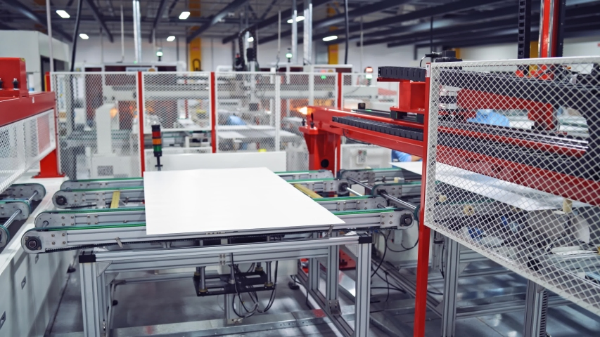 Modern industrial factory background. Automated machinery working inside manufacturing plant. Process of robotic equipment. | Shutterstock HD Video #1038983015