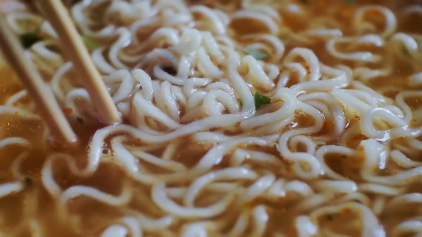 Chinese noodles with broth and spices. closeup. | Shutterstock HD Video #1039031015