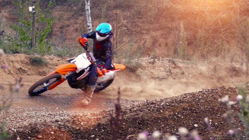 Extreme Motocross MX Rider riding on dirt track on a sunny late summer day on public training session in preparation for Motocross event - slow motion shot | Shutterstock HD Video #1039181705