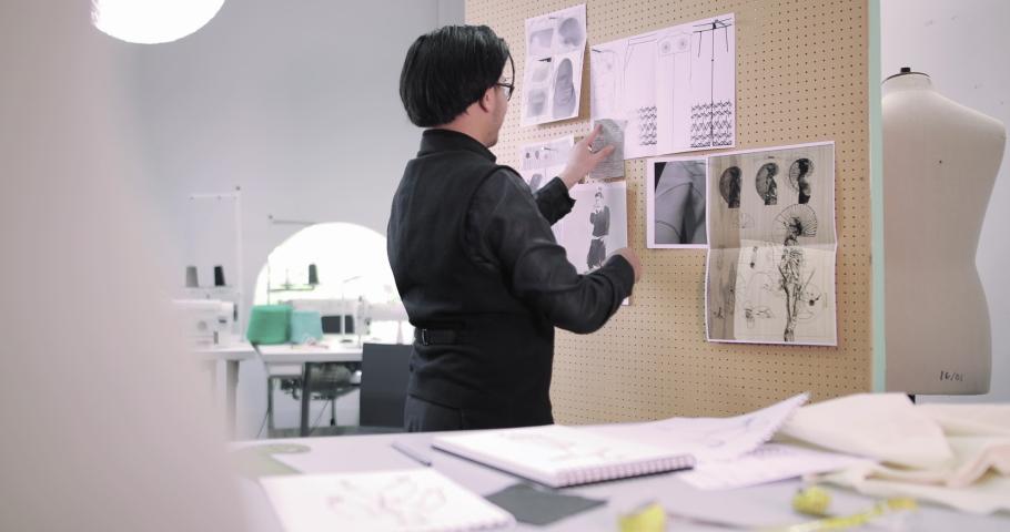 Fashion designer selecting fabrics for designs | Shutterstock HD Video #1039185995