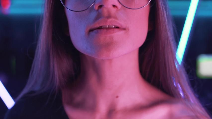High Fashion model woman in  neon lights posing in studio | Shutterstock HD Video #1039211645