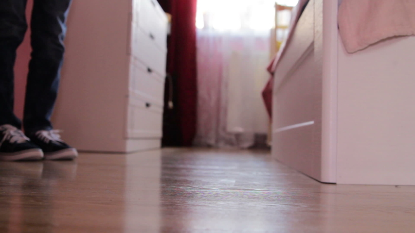 In sneakers goes into the bedroom,feet boy go to bed in the bedroom in sneakers | Shutterstock HD Video #1039229825