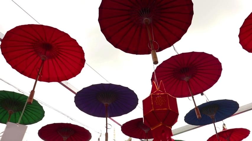 Umbrellas made of colorful fabrics, Thai crafts Lanna umbrella,Chiang Mai Thailand. | Shutterstock HD Video #1039281335