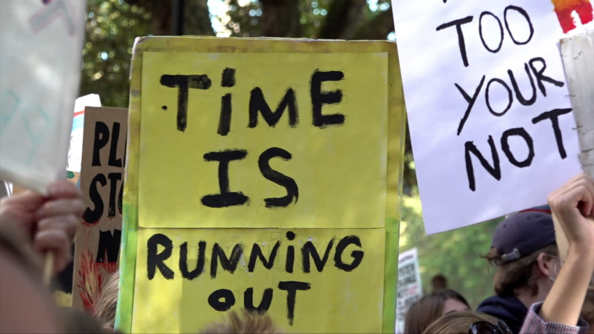 """London / United Kingdom (UK) - 09 20 2019: A placard is held up that says """"Time is running out"""" 