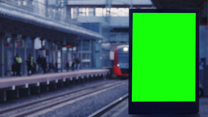Empty modern billboard with a green screen for advertising, on a train station, blank billboard on subway station opposite the train arriving at the platform | Shutterstock HD Video #1039900175