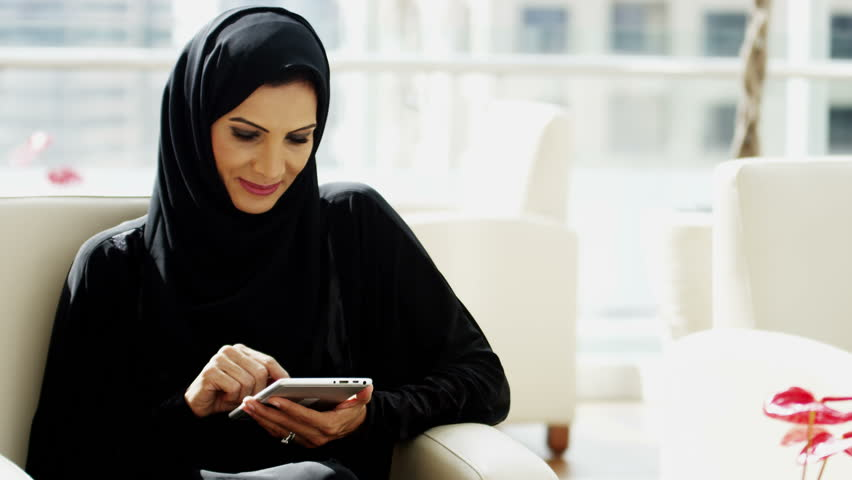 Arab Gulf business female tablet technology city traveller tourism investment