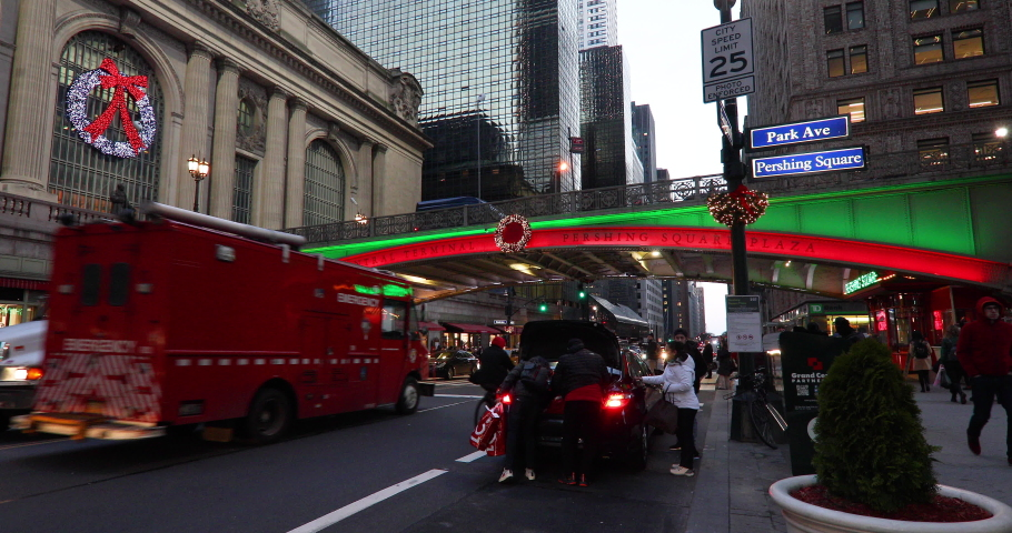 NEW YORK CITY, NEW YORK - DECEMBER 26, 2018: Traffic on 42nd St. by Grand Central Terminal, Pershing Square and Park Avenue in midtown Manhattan, NYC with wreaths and Christmas lights.