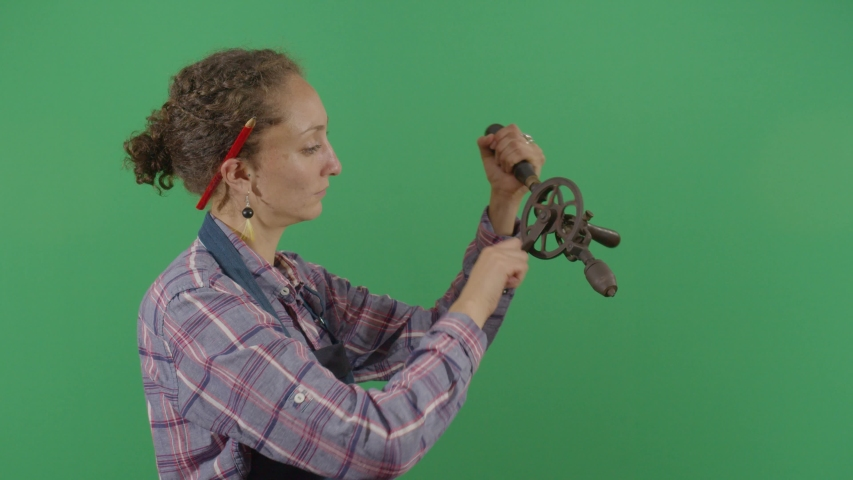 Woman Carpenter Testing A Drill On The Green Screen. Studio Isolated Shot Against Green Screen Background | Shutterstock HD Video #1040502995