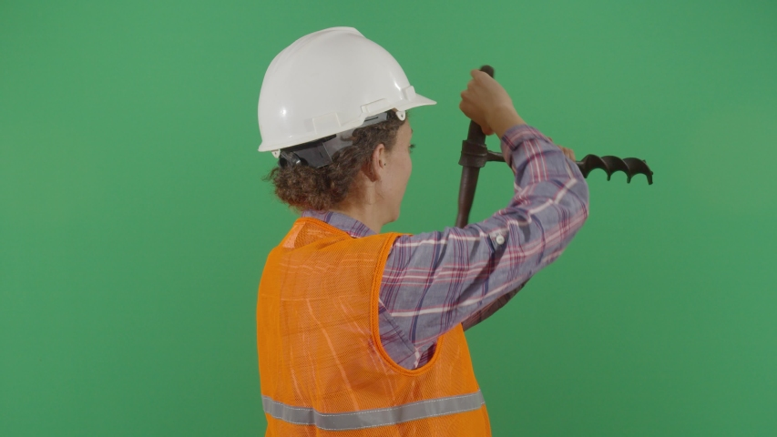 Woman Engineer Drilling The Green Screen. Studio Isolated Shot Against Green Screen Background | Shutterstock HD Video #1040503145