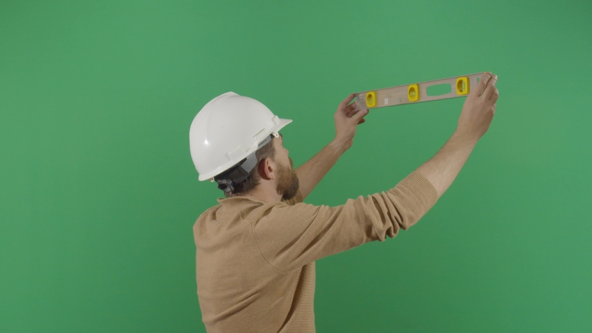 Adult Man Engineer Using A Level On Green Screen. Studio Isolated Shot Against Green Screen Background | Shutterstock HD Video #1040503355