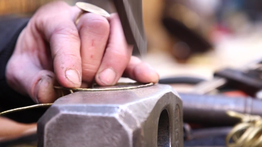 Artisan realizes jewelery with hands and hammer  | Shutterstock HD Video #1040545565