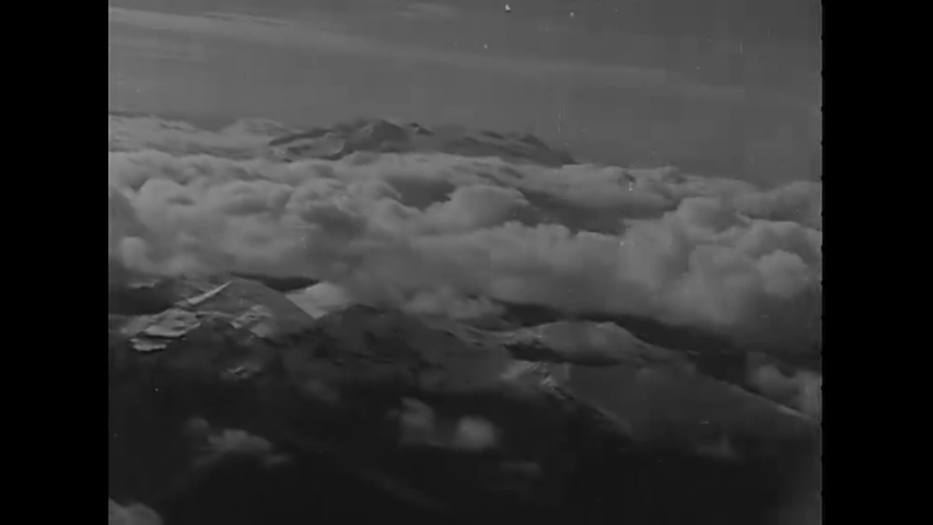 CIRCA 1943 - Aerial footage shows snow-covered mountains of Alaska. | Shutterstock HD Video #1040581835