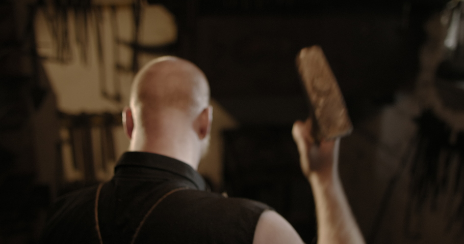 View From Behind Of Bald Man Hitting Something Repeatedly With Hammer | Shutterstock HD Video #1040605235