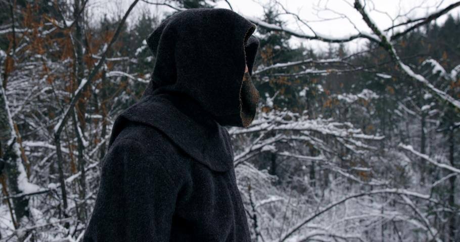 Hooded Man In Winter Landscape Walks Down Path And Swings Hammer On Shoulder | Shutterstock HD Video #1040605295